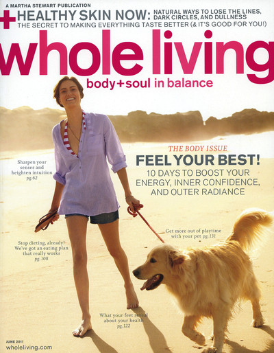 Cover of Whole Living Magazine with woman and dog walking on beach