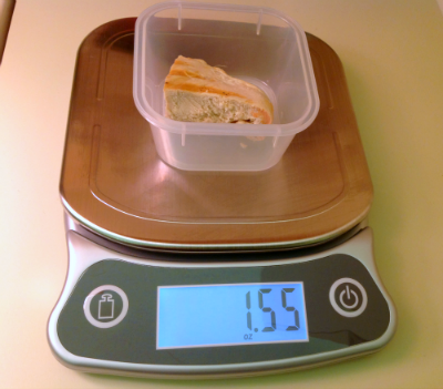 measure chicken breast on kitchen scale for diet